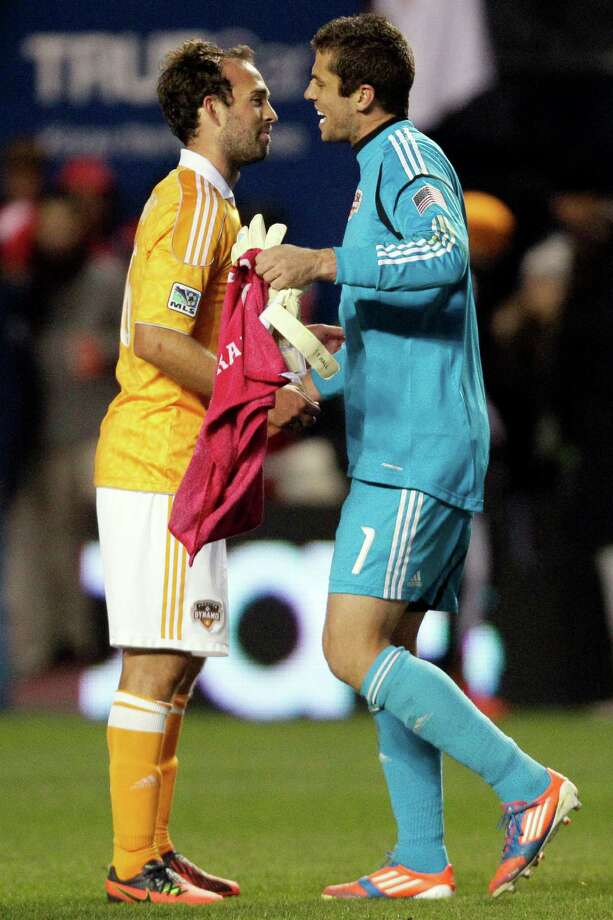 Houston Dynamo midfielder Adam Moffat (16), left, celebrates with goalie Tally Hall (1) after they defeated the Chicago Fire 2-1 in an MLS soccer playoff match, Wednesday, Oct. 31, 2012, in Bridgeview, Ill. (AP Photo/Nam Y. Huh) Photo: Nam Y. Huh, Associated Press / AP
