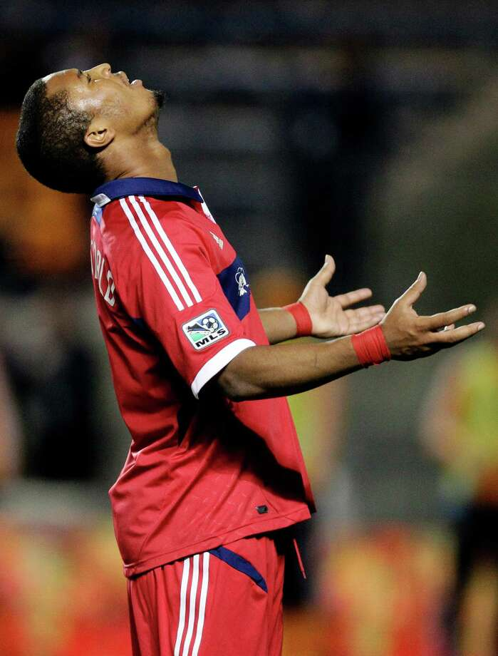 Chicago Fire forward Sherjill MacDonald (7) reacts after missing a pass against the Houston Dynamo  during the second half of their MLS soccer playoff match, Wednesday, Oct. 31, 2012, in Bridgeview, Ill. Houston won 2-1. (AP Photo/Nam Y. Huh) Photo: Nam Y. Huh, Associated Press / AP