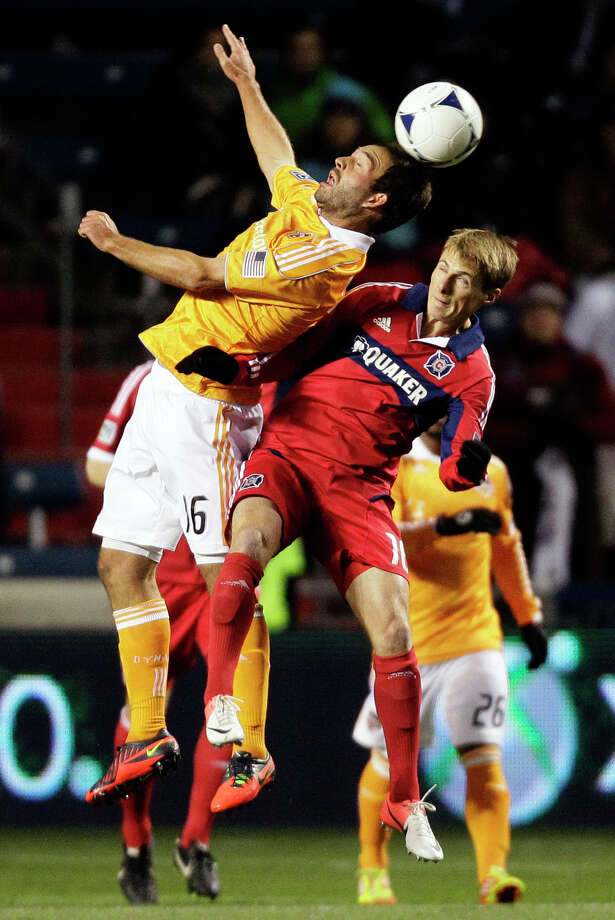 Houston Dynamo midfielder Adam Moffat (16) and Chicago Fire forward Chris Rolfe (18) battle for the ball during the first half of their playoff MLS soccer match, Wednesday, Oct. 31, 2012, in Bridgeview, Ill. (AP Photo/Nam Y. Huh) Photo: Nam Y. Huh, Associated Press / AP