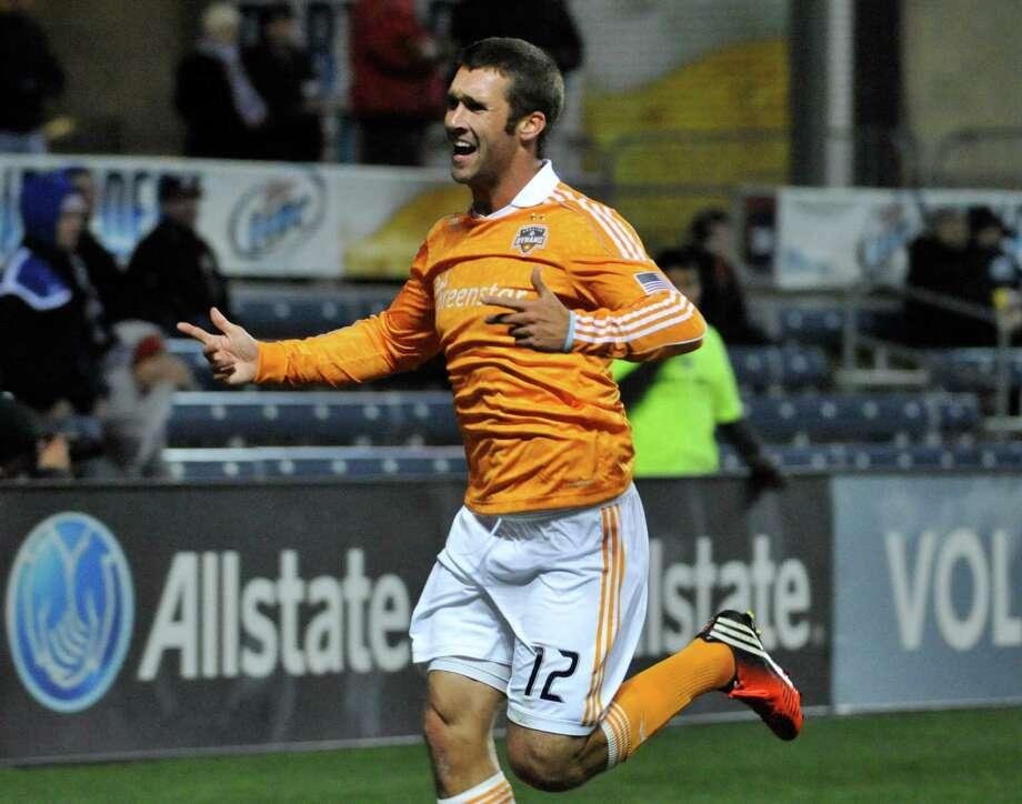 BRIDGEVIEW, IL - OCTOBER 31: Will Bruin #12 of Houston Dynamo celebrates his goal against the Chicago Fire in an MLS match on October 31, 2012 at Toyota Park in Bridgeview, Illinois. Photo: David Banks, Getty Images / Getty Images North America