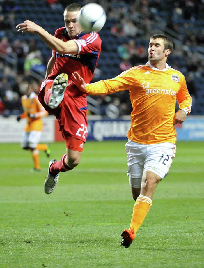 BRIDGEVIEW, IL - OCTOBER 31: Austin Berry #22 of Chicago Fire and Will Bruin #12 of Houston Dynamo vie for the ball in an MLS match on October 31, 2012 at Toyota Park in Bridgeview, Illinois. Photo: David Banks, Getty Images / Getty Images North America