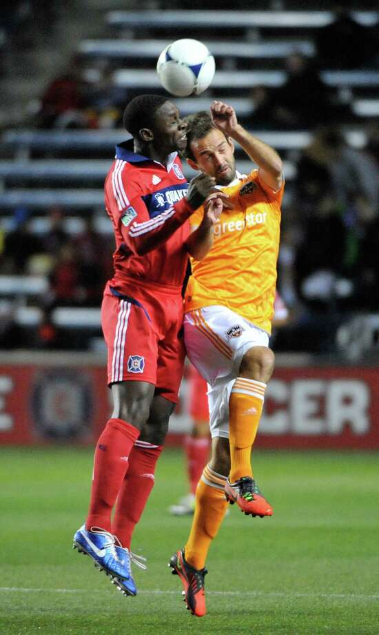 BRIDGEVIEW, IL - OCTOBER 31: Jalil Anibaba #6 of Chicago Fire (L) and Adam Moffat #16 of Houston Dynamo head the ball in an MLS match on October 31, 2012 at Toyota Park in Bridgeview, Illinois. Photo: David Banks, Getty Images / Getty Images North America