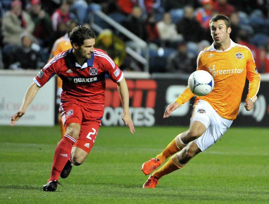 BRIDGEVIEW, IL - OCTOBER 31: Arne Friedrich #23 of Chicago Fire and Will Bruin #12 of Houston Dynamo go for the ball in an MLS match on October 31, 2012 at Toyota Park in Bridgeview, Illinois. Photo: David Banks, Getty Images / Getty Images North America