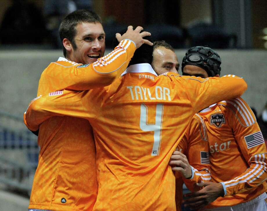 BRIDGEVIEW, IL - OCTOBER 31: Will Bruin #12 of Houston Dynamo (L) celebrates his goal with Jermaine Taylor #4 against the Chicago Fire in an MLS match on October 31, 2012 at Toyota Park in Bridgeview, Illinois. Photo: David Banks, Getty Images / Getty Images North America