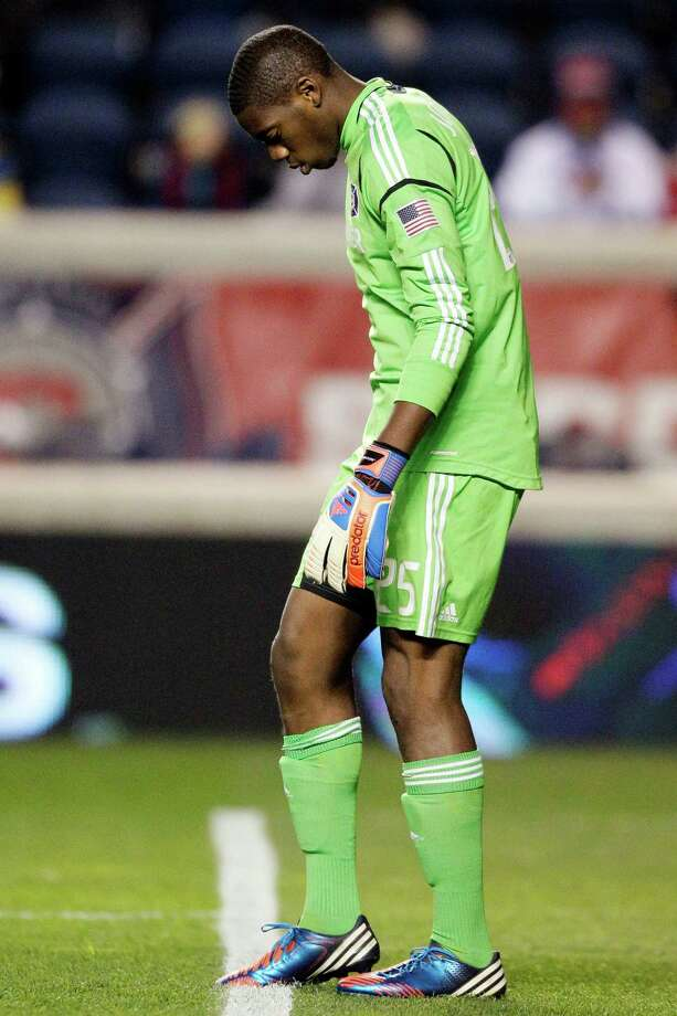 Chicago Fire goalie Sean Johnson (25) reacts after Houston Dynamo forward Will Bruin scored during the first half of their playoff MLS soccer match, Wednesday, Oct. 31, 2012, in Bridgeview, Ill. (AP Photo/Nam Y. Huh) Photo: Nam Y. Huh, Associated Press / AP