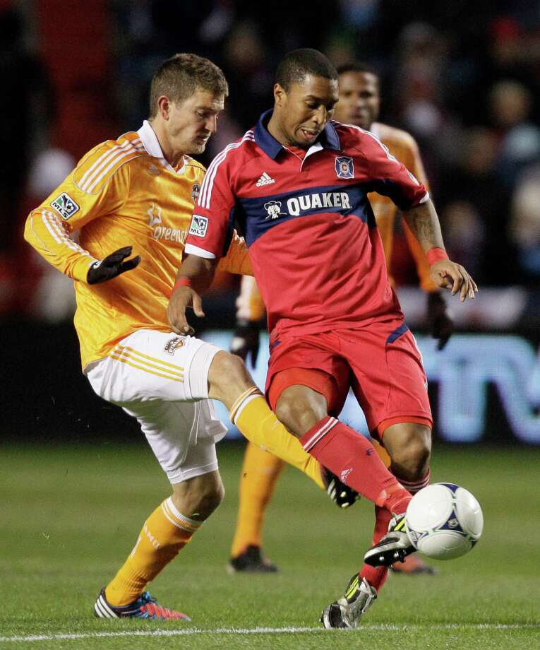 Chicago Fire forward Sherjill MacDonald (7) controls the ball against Houston Dynamo defender Bobby Boswell (32)during the first half of an MLS soccer playoffs on Wednesday, Oct. 31, in Bridgeview, Ill. The Dynamo won 2-1. (AP Photo/Nam Y. Huh) Photo: Nam Y. Huh, Associated Press / AP
