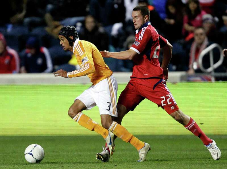 Houston Dynamo forward Calen Carr (3) controls the ball against Chicago Fire defender Austin Berry (