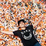 Katy Juranty makes a confetti angel on Market Street after the Giants World Series Championship parade in San Francisco, Calif., Wednesday, October 31, 2012.