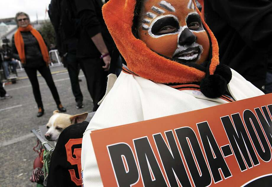 Jeanne Marie Scorseter came in full makeup with her chihuahua Tostito to the presentation at City hall as the city of San Francisco celebrated the Giants victory as World Series Champions with a parade and ceremony at Civic Center Plaza on Wednesday, October 31, 2012. Photo: Carlos Avila Gonzalez, The Chronicle