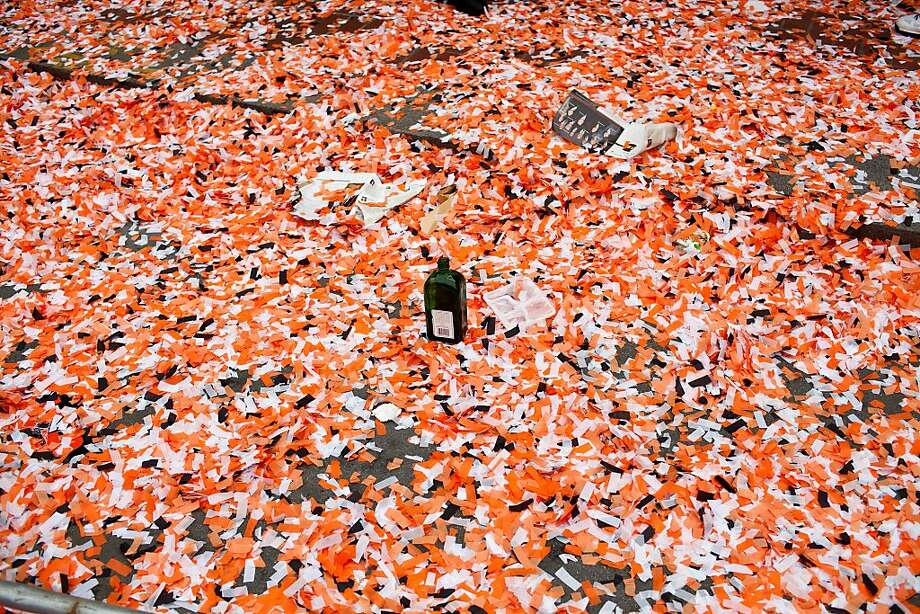 An empty liquor bottle sits on Market Street amid a sea of confetti after the Giants World Series Championship parade in San Francisco, Calif., Wednesday, October 31, 2012. Photo: Jason Henry, Special To The Chronicle