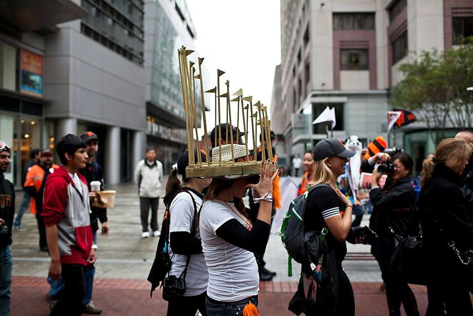 Megan Hurley wore a World Series trophy hat her brother made the night before for the Giants World Series Championship parade in San Francisco, Calif., Wednesday, October 31, 2012. Photo: Jason Henry, Special To The Chronicle