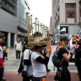 Megan Hurley wore a World Series trophy hat her brother made the night before for the Giants World Series Championship parade in San Francisco, Calif., Wednesday, October 31, 2012.