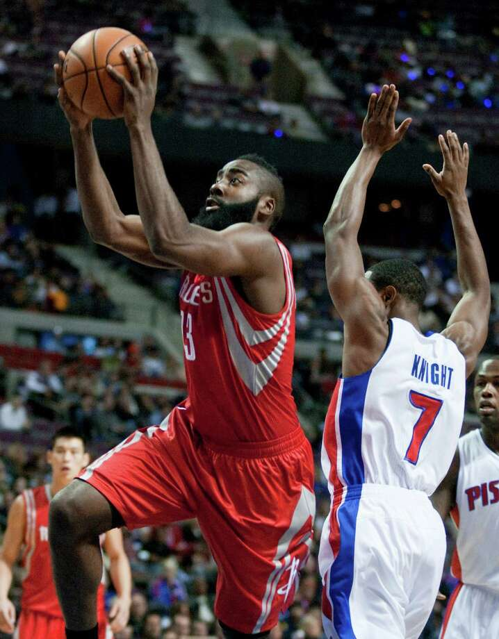 On the day he signed a five-year, $80 million extension with the Rockets, James Harden proved his worth with a 37-point effort in the opener against Brandon Knight, right, and the Pistons. Photo: Duane Burleson, FRE