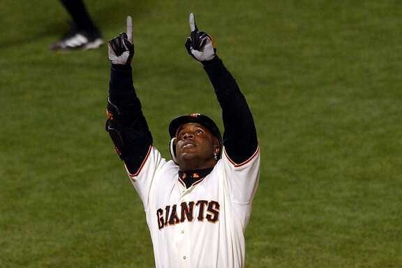 San Francisco Giants' Barry Bonds reacts as he touches home plate after hitting his 600th career home run, a solo shot off of Pittsburgh Pirates pitcher Kip Wells during the sixth inning at Pacific Bell Park in San Francisco, Friday, Aug. 9, 2002. (AP Photo/Marcio Jose Sanchez)