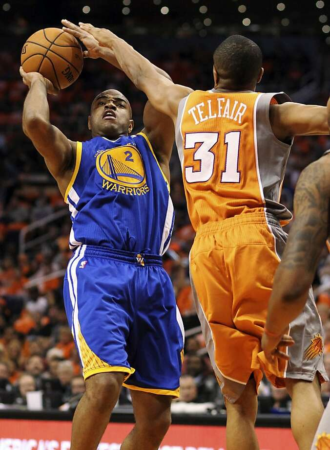 Golden State Warriors guard Jarrett Jack (2) shoots as he is guarded by Phoenix Suns guard Sebastian Telfair, right, in the first quarter of an NBA basketball game, Wednesday, Oct. 31, 2012, in Phoenix. (AP Photo/Paul Connors) Photo: Paul Connors, Associated Press