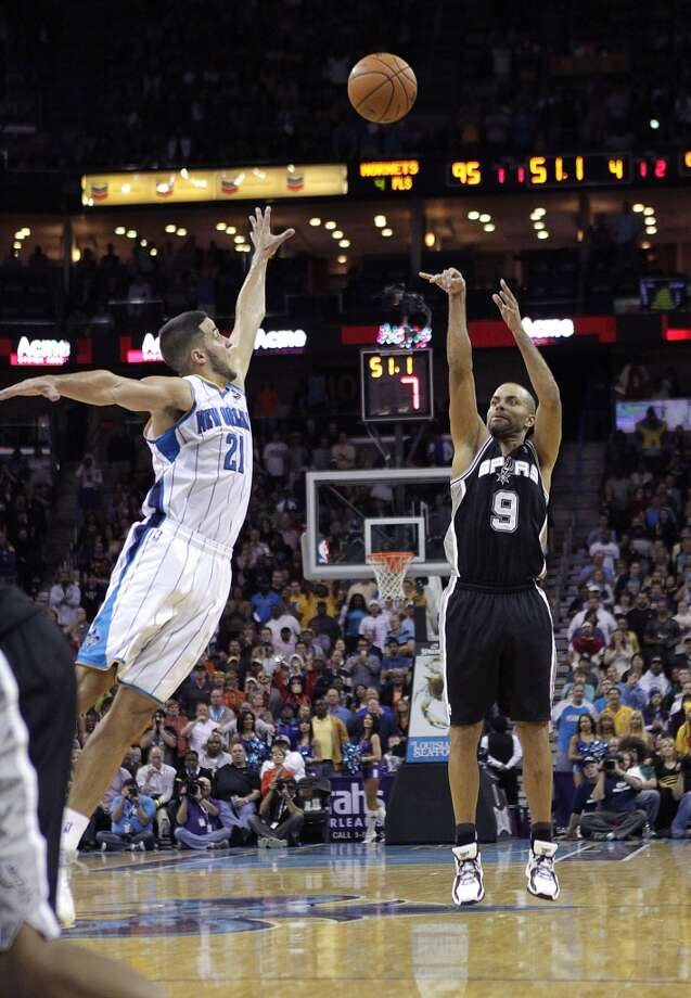 San Antonio Spurs point guard Tony Parker (9) hits a three-pointer over New Orleans Hornets point guard Greivis Vasquez (21) with 51 second remaining in the game to punt the Spurs ahead for good in the second half of an NBA basketball game in New Orleans, Wednesday, Oct. 31, 2012. The Spurs won 95-99. (AP Photo/Gerald Herbert) (Associated Press)