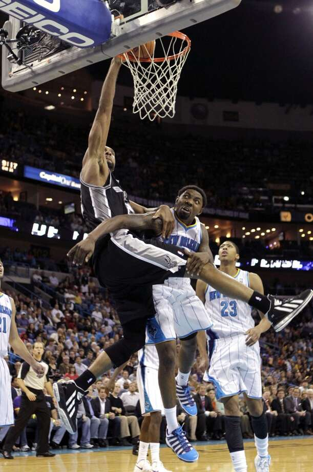 San Antonio Spurs power forward Tim Duncan  goes to the basket against New Orleans Hornets shooting guard Roger Mason Jr., right, in the second half of an NBA basketball game in New Orleans, Wednesday, Oct. 31, 2012. The Spurs won 95-99. (AP Photo/Gerald Herbert) (Associated Press)