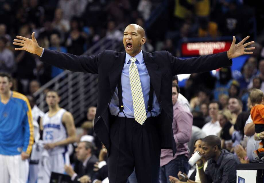 New Orleans Hornets head coach Monty Williams calls out to his team in the second half of an NBA basketball game against the San Antonio Spurs in New Orleans, Wednesday, Oct. 31, 2012. The Spurs won 95-99. (AP Photo/Gerald Herbert) (Associated Press)