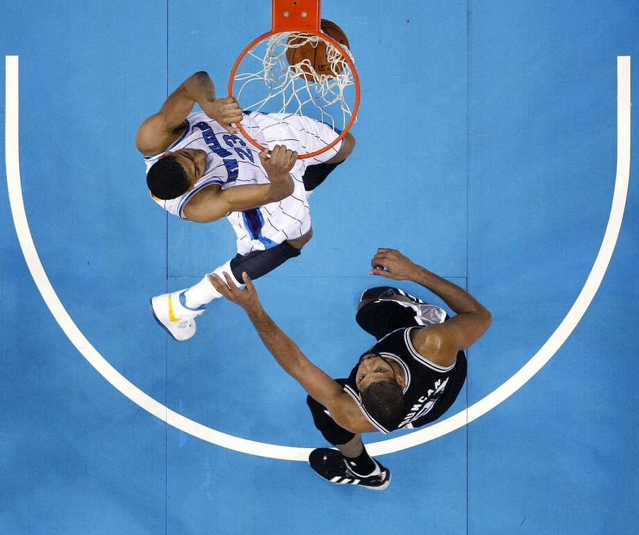 New Orleans Hornets power forward Anthony Davis (23) slam dunks in front of San Antonio Spurs power forward Tim Duncan (21) in the second half of an NBA basketball game in New Orleans, Wednesday, Oct. 31, 2012. The Spurs won 95-99. (AP Photo/Gerald Herbert) (Associated Press)