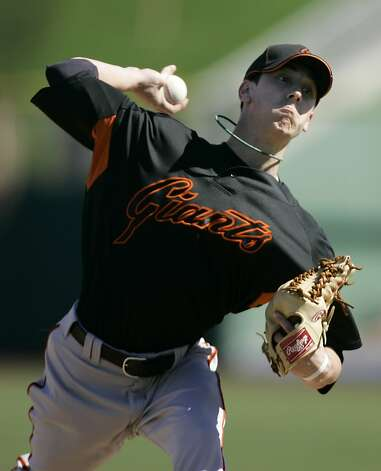 Tim Lincecum had short hair, no Cy Youngs and no World Series rings when he threw in spring training in 2007. Photo: Eric Risberg, AP
