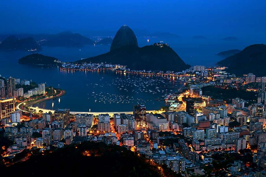 Night vue of the Guanabara bay with the Sugar Leaf hill in the background (C) in Rio de Janeiro on October 30, 2012, Brazil.   AFP PHOTO / CHRISTOPHE SIMON/AFP/Getty Images Photo: Christophe Simon, AFP/Getty Images
