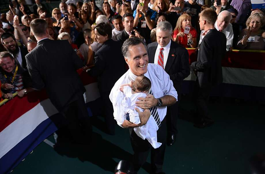 US Republican Presidential candidate Mitt Romney holds a supporter's baby during a rally at the University of Miami in Coral Gables, Florida, on October 31, 2012.     AFP PHOTO/EMMANUEL DUNAND/AFP/Getty Images Photo: Emmanuel Dunand, AFP/Getty Images