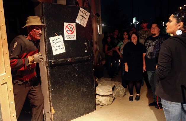 Michael Kitchen, aka Freddy Krueger, waits for customers at Nightmare on Grayson, Wednesday, Oct. 31, 2012. The event is schedule to move out of the East Grayson Street location for the next run. Friday and Saturday night are the last shows on scheduled. Photo: Jerry Lara, San Antonio Express-News / San Antonio Express-News