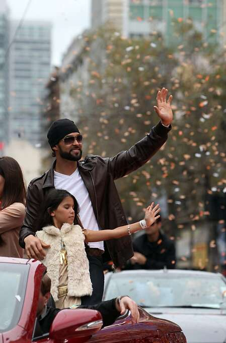 Angel Pagan waves to the crowd as he rides in a car with his family during the San Francisco Giants World Series victory parade on Wednesday, October 31, 2012 in San Francisco, Calif. Photo: Lea Suzuki, The Chronicle