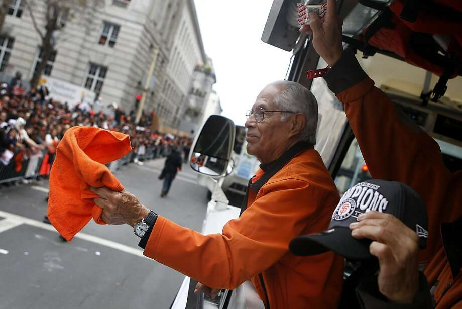 Pablo Aguilar, 82,  with maintenance waves a rally towel as he rides a Ride the Ducks vehicle during the San Francisco Giants World Series victory parade on Wednesday, October 31, 2012 in San Francisco, Calif. Photo: Lea Suzuki, The Chronicle