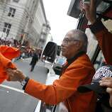 Pablo Aguilar, 82,  with maintenance waves a rally towel as he rides a Ride the Ducks vehicle during the San Francisco Giants World Series victory parade on Wednesday, October 31, 2012 in San Francisco, Calif.