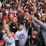 Giants fans try to catch chocolate thrown from a passing Ride the Ducks vehicle along the parade route during the San Francisco Giants World Series victory parade on Wednesday, October 31, 2012 in San Francisco, Calif.