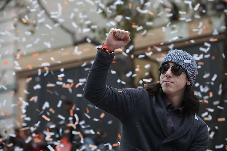 Giants pitcher Tim Lincecum pumps his fist as he rides through confetti along the parade route during the San Francisco Giants World Series victory parade on Wednesday, October 31, 2012 in San Francisco, Calif. Photo: Lea Suzuki, The Chronicle