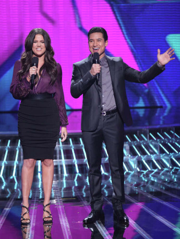 THE X FACTOR: TOP 16: L-R: Khloe Kardashian Odom and Mario Lopez host THE X FACTOR, Wednesday, October 31 (8:00-10:00 PM ET/PT) on FOX. CR: Brian Dowling/ FOX.