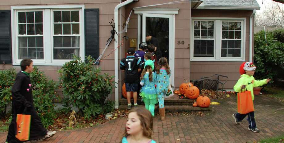 Even fierce Hurricane Sancy couldn't scare the Halloween spirit away in Westport. After officials said trick-or-treating could go forward Wednesday, kids across town -- as here, in the Oak Street/Maplewood Avenue neighborhood -- ventured forth to collect a holiday haul of sweets. Photo: Jarret Liotta