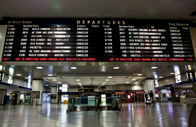 A timetable board displays continued cancellations at Penn Station as MTA resumed limited service on Thursday, Nov. 1, 2012, in New York. The decision to reopen undamaged parts of the nation's largest transit system came as the region struggles to restore other basic services to recover from a storm that ravaged the East Coast, killing more than 70 people and leaving millions powerless. Photo: CX Matiash