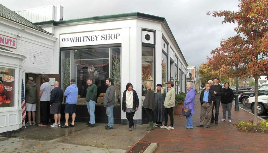 In a scene played out throughout lower Fairfield County, the line is long outside the Dunkin Donuts on Elm Street on Tuesday morning after Hurricane Sandy swept through town. Photo: Tyler Woods