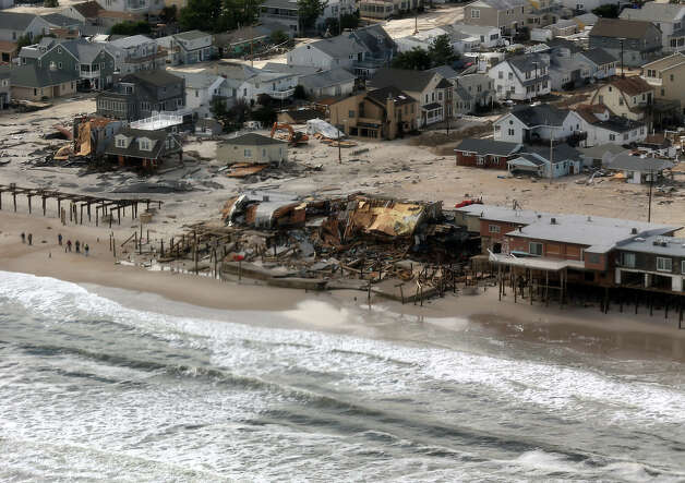 The view of storm damage over the Atlantic Coast from the helicopter following Marine One with US President Barack Obama and Governor Chris Christie as they view the storm damage in Seaside Heights, New Jersey, on October 31, 2012. Americans sifted through the wreckage of superstorm Sandy on Wednesday as millions remained without power. The storm carved a trail of devastation across New York City and New Jersey, killing dozens of people in several states, swamping miles of coastline, and throwing the tied-up White House race into disarray just days before the vote. AFP PHOTO/POOL/Doug Mills Photo: AFP, AFP/Getty Images / 2012 AFP