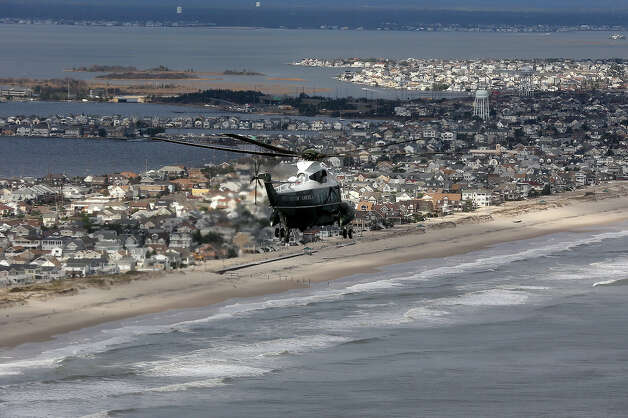 The view of storm damage over the Atlantic Coast from the helicopter following Marine One (C) with US President Barack Obama and Governor Chris Christie as they view the storm damage in Seaside Heights, New Jersey, on October 31, 2012. Americans sifted through the wreckage of superstorm Sandy on Wednesday as millions remained without power. The storm carved a trail of devastation across New York City and New Jersey, killing dozens of people in several states, swamping miles of coastline, and throwing the tied-up White House race into disarray just days before the vote. AFP PHOTO/POOL/Doug Mills Photo: AFP, AFP/Getty Images / 2012 AFP