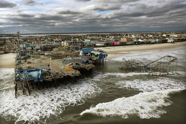 SEASIDE HEIGHTS, NJ - OCTOBER 31:  Waves break in front of a destroyed amusement park wrecked by Hurricane Sandy on October 31, 2012 in Seaside Heights, New Jersey.  At least 50 people were reportedly killed in the U.S. by Sandy with New Jersey suffering massive damage and power outages. Photo: Mario Tama, Getty Images / 2012 Getty Images
