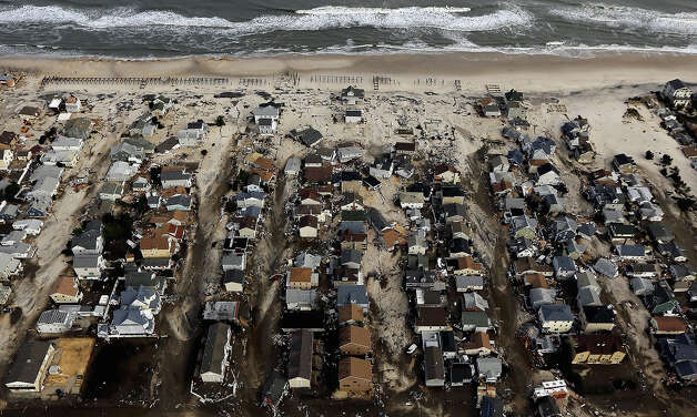 SEASIDE HEIGHTS, NJ - OCTOBER 31:  Homes sit in ruin next to the Atlantic Ocean after being destroyed by Hurricane Sandy on October 31, 2012 in Seaside Heights, New Jersey.  At least 50 people were reportedly killed in the U.S. by Sandy with New Jersey suffering massive damage and power outages. Photo: Mario Tama, Getty Images / 2012 Getty Images