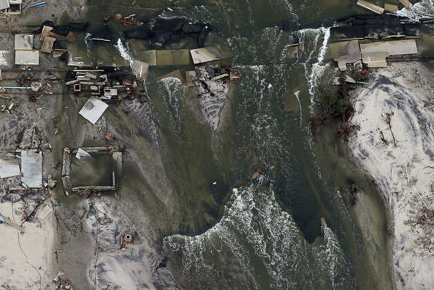 MANTOLOKING, NJ - OCTOBER 31:  Homes sit in ruin after flooding from Superstorm Sandy on October 31, 2012 in Mantoloking, New Jersey.  At least 50 people were reportedly killed in the U.S. by Sandy with New Jersey suffering massive damage and power outages. Photo: Mario Tama, Getty Images / 2012 Getty Images