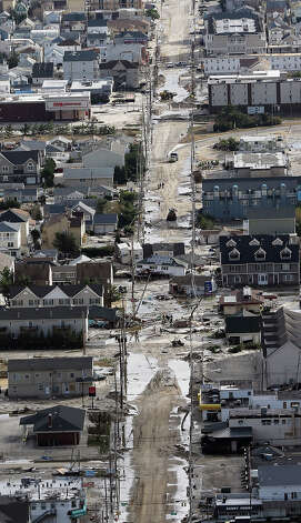 SEASIDE HEIGHTS, NJ - OCTOBER 31: Destroyed homes wrecked by Superstorm Sandy sits in the middle of a street on October 31, 2012 in Seaside Heights, New Jersey. At least 50 people were reportedly killed in the U.S. by Sandy with New Jersey suffering massive damage and power outages. Photo: Mario Tama, Getty Images / 2012 Getty Images