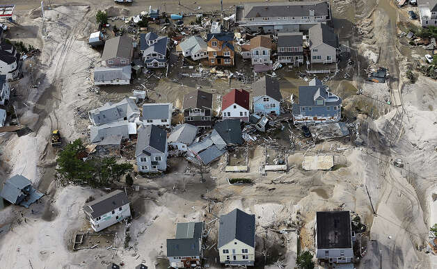 SEASIDE HEIGHTS, NJ - OCTOBER 31: Homes wrecked by Superstorm Sandy sit amongst sand washed ashore on October 31, 2012 in Seaside Heights, New Jersey. At least 50 people were reportedly killed in the U.S. by Sandy with New Jersey suffering massive damage and power outages. Photo: Mario Tama, Getty Images / 2012 Getty Images