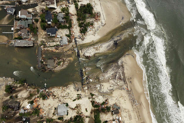 MANTOLOKING, NJ - OCTOBER 31: Destroyed homes sit at the edge of the Atlantic Ocean after Superstorm Sandy on October 31, 2012 in Mantoloking, New Jersey. At least 50 people were reportedly killed in the U.S. by Sandy with New Jersey suffering massive damage and power outages. Photo: Mario Tama, Getty Images / 2012 Getty Images