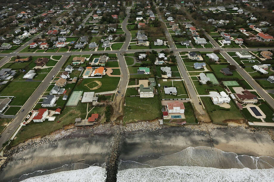 LONG BRANCH, NJ - OCTOBER 31: Rubble from Superstorm Sandy remains by homes at the edge of the Atlantic Ocean on October 31, 2012 in Long Branch, New Jersey. At least 50 people were reportedly killed in the U.S. by Sandy with New Jersey suffering massive damage and power outages. Photo: Mario Tama, Getty Images / 2012 Getty Images