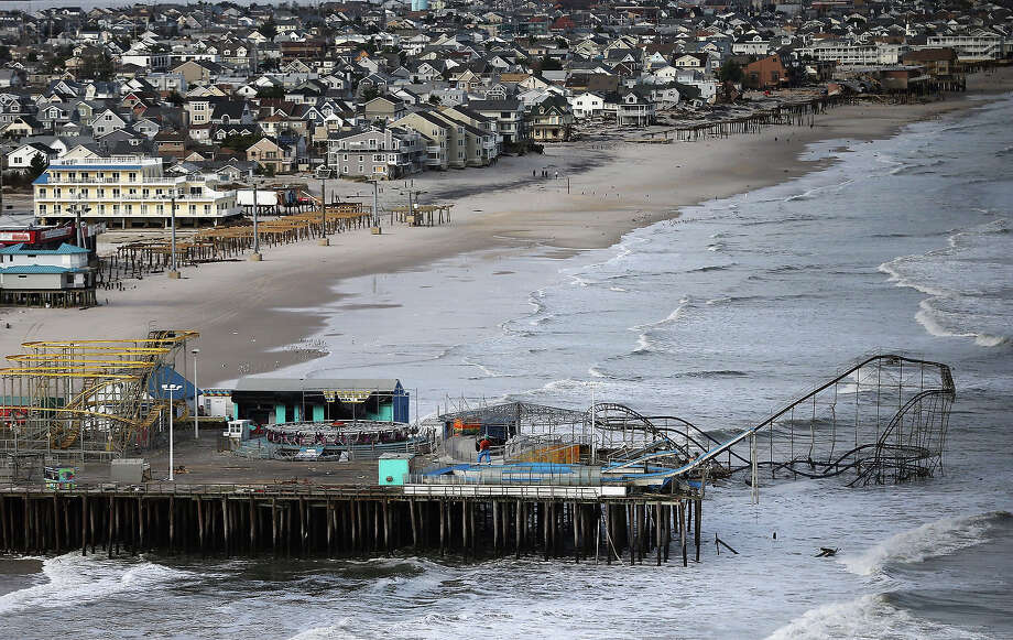 SEASIDE HEIGHTS, NJ - OCTOBER 31:  Waves break in front of a destroyed amusement park wrecked by Superstorm Sandy on October 31, 2012 in Seaside Heights, New Jersey. At least 50 people were reportedly killed in the U.S. by Sandy with New Jersey suffering massive damage and power outages. Photo: Mario Tama, Getty Images / 2012 Getty Images