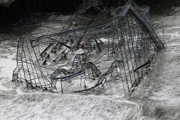 Surf rolls past a destroyed roller coaster wrecked by Superstorm Sandy on October 31, 2012 in Seaside Heights, New Jersey. At least 50 people were reportedly killed in the U.S. by Sandy with New Jersey suffering massive damage and power outages. Photo: Mario Tama, Getty Images / 2012 Getty Images