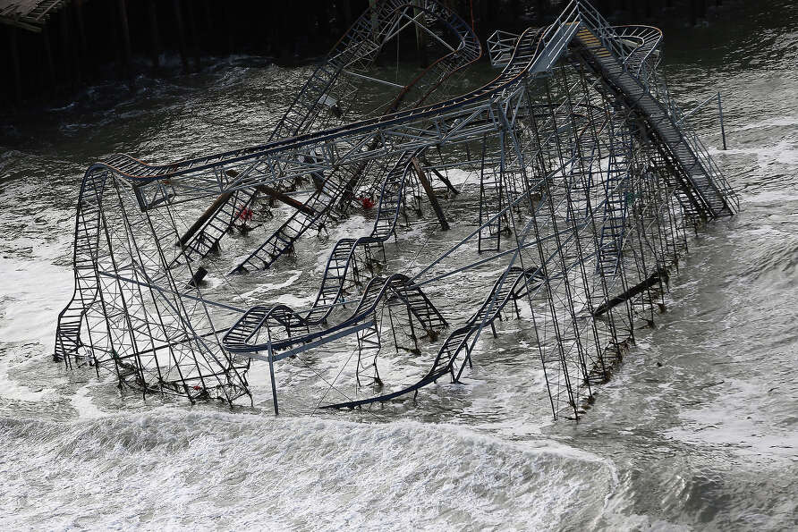 Surf rolls past a destroyed roller coaster wrecked by Superstorm Sandy on October 31, 2012 in Seasid