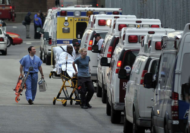 A patient is evacuated from Bellevue Hospital on October 31, 2012 in New York. The hospital had been operating on backup generators since losing power during Hurricane Sandy but had to be evacuated once the extent of the damage became clear.  AFP PHOTO/Stan HONDA Photo: STAN HONDA, AFP/Getty Images / 2012 AFP