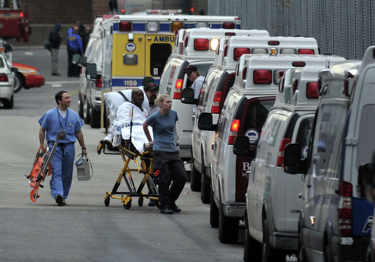 A patient is evacuated from Bellevue Hospital on October 31, 2012 in New York. The hospital had been